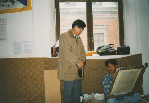 Here i am demonstrating the art of thangka painting in Warsaw, with a Chinese onlooker, reportedly a spy according to some !