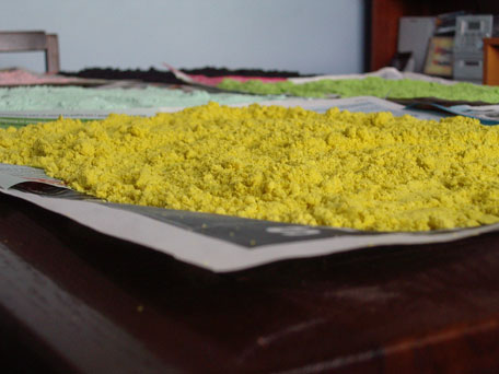 The coloured sand used for the mandalas and latterly in my sand art workshops is hand coloured - here is a lot in the drying process in my living room