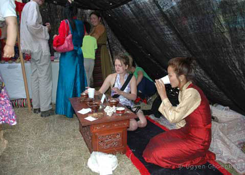 Tasters of tibetan butter tea on the occasion of His Holiness the Dalai Lama's 75th birthday, drunk in traditional black yak hair tent of the nomads of western tibet. <br>This tent was stitched by my family & relatives who had a wonderful time recalling their nomadic life in Tibet, but under a hot south indian sun.